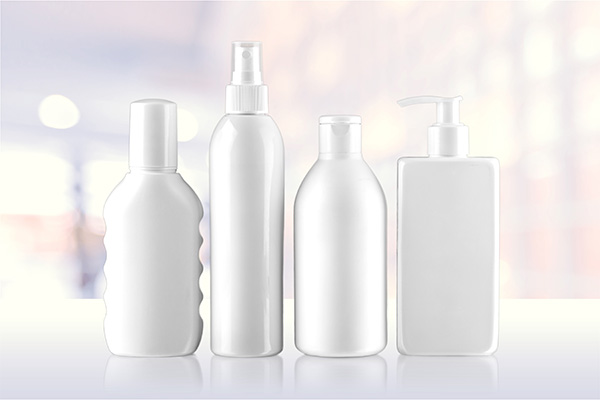 four personal care bottles