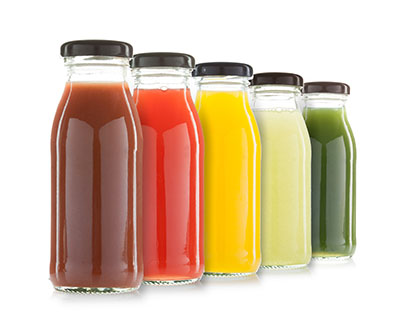 Drinks, such as fruit and vegetable-based beverages, are safe in glass bottles due to their non-toxic material.