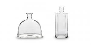 The Scala bottle curved shape offers an interesting look for spirits, like tequila. The height and bold lines of the Quartz bottle portray a strong presence for your spirits.